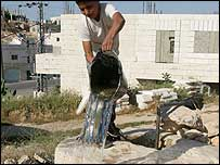 Palestinian boy drawing water from a well (Photo: Fadi Tannas)