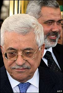 Palestinian President Mahmoud Abbas (L) and Prime Minister Ismail Haniya