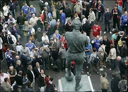 Fans visit Bobby Moore's statue