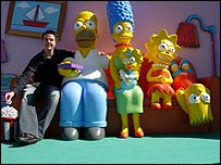 The BBC's Stephen Robb (left) with The Simpsons