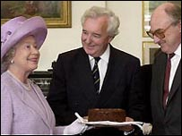 Peter Baxter and Henry Blofeld present a cake to the Queen (2001)