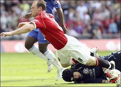 Wayne Rooney is denied by Petr Cech