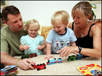 Kate and Gerry McCann play with their twins Sean and Amelie