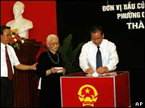 Communist Party chief Nong Duc Manh (right) votes in Hanoi