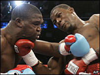 Jermain Taylor (right) lands an upper cut on Cory Spinks
