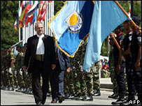 President Jose Ramos-Horta inspects an honour guard after being sworn in