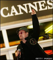 U2 singer Bono performing in Cannes