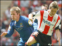 Adam Yates (left) and Exeter's Lee Elam battle for possession