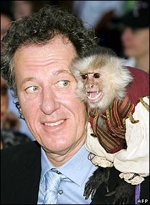 Geoffrey Rush with monkey at premiere of Pirates of the Caribbean: At World's End