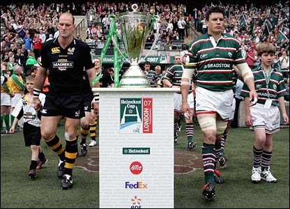 Club captains Lawrence Dallaglio and Martin Corry lead their teams out at Twickenham
