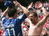 Gary Thompson and Danny Carlton celebrate Morecambe's winner