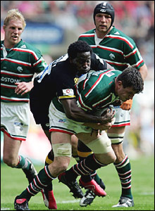 Leicester captain Martin Corry is tackled by Paul Sackey