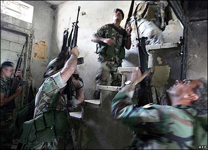 Lebanese troops on their way into a building, Tripoli