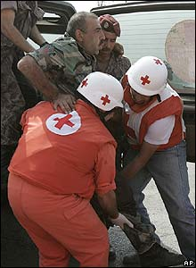 Red Cross volunteers help a wounded Lebanese soldier