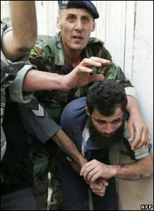 Lebanese troops arrest a suspected militant