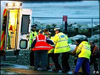 Rescue workers carry a body into an ambulance in Morecambe in 2004
