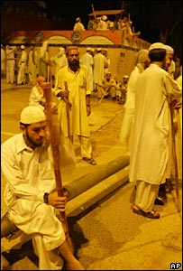 Islamic students stand guard outside the Red Mosque in Islamabad