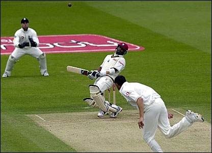 Daren Ganga (centre) avoids a bouncer from Steve Harmison (bottom)