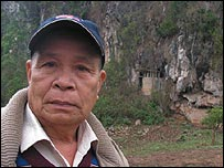 Onechanh Somany in front of caves in cave in Viengxay, Laos, 2007