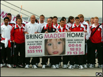 The Liverpool FC team with a banner for Madeleine