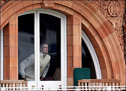Kevin Pietersen peers through a window at a gloomy Lord's