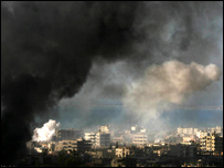 Smoke rises from the camp as fighting continued on Monday