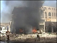 TV news grab of bomb aftermath in Baghdad's Amil district