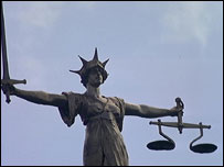 Old Bailey statue showing the Scales of Justice.