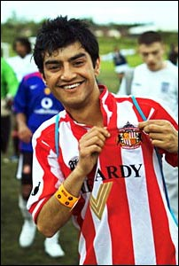 A Mackem displays the Sunderland badge