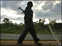 A Tamil tiger rebel on patrol