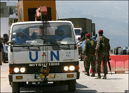 UN aid trucks carrying food and water wait to enter the refugee camp