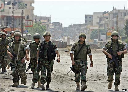 Lebanese soldiers patrol a street near the refugee camp