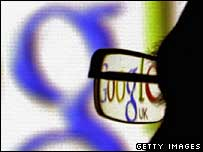 Google logo seen through pair of glasses