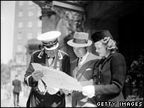 Man and woman consulting a map in 1939