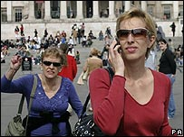 Woman listening to a mobile phone
