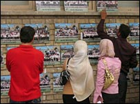 Students view graduation photographs