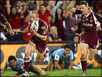 Darren Lockyer runs in for his crucial score