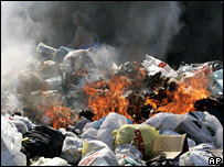 Piles of burning rubbish in Naples street