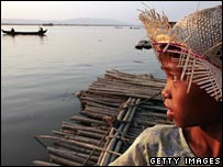 A Burmese girl watching a boat