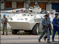 Congolese police walk past a United Nations position 15 March 2007 in Kinshasa