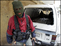 A masked fighter from Fatah al-Islam in Nahr al-Bared on 23 May 2007
