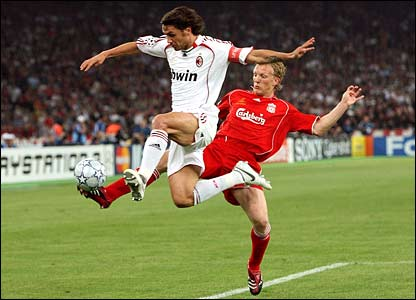 Liverpool's Dirk Kuyt and Paolo Maldini of AC Milan