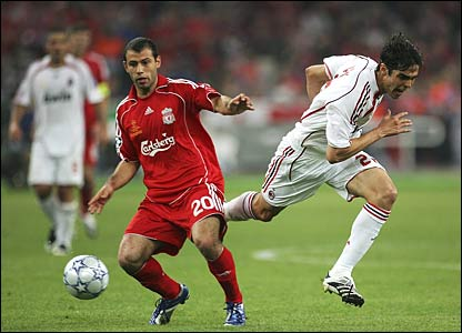 Kaka of Milan is tackled by Javier Mascherano