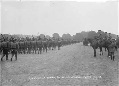 Lord Kitchener, on horseback, reviews troops of 10th Division at Basingstoke.