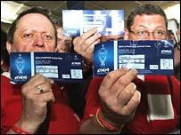 Liverpool fans show off their tickets