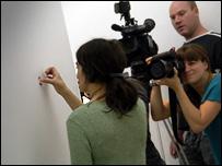 Yael Davids adjusts one of her panels