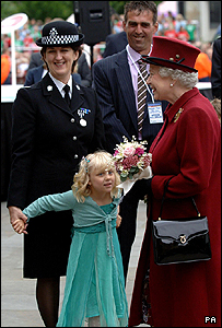 Lydia Beshenivsky presents the Queen with a posy