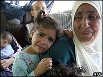 A Palestinian girl and her mother weep as they flee the Nahr al-Bared camp