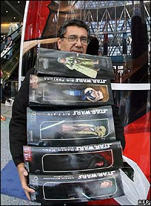 A Star Wars fan with an armful of new purchases