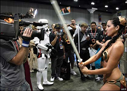 A fan dressed as Princess Leia parades for TV cameras